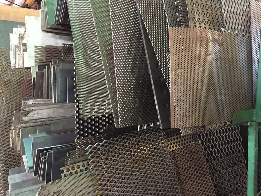 Several pieces of perforated steel
